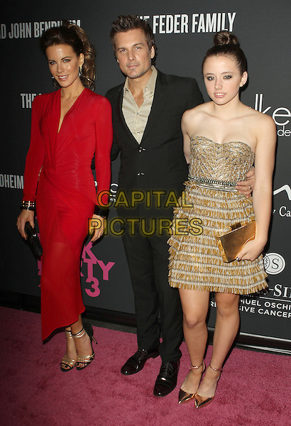 Kate Beckinsale, Len Wiseman, Lily Mo Sheen<br /> The Pink Party 2013 held at the Santa Monica Airport, Santa Monica, California, USA.<br /> October 19th, 2013<br /> full length dress red strapless yellow beige black suit married husband wife <br /> CAP/ADM/KB<br /> &copy;Kevan Brooks/AdMedia/Capital Pictures