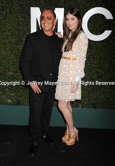 BEVERLY HILLS, CA- OCTOBER 02: Designer Michael Kors (L) and actress Hailee Steinfeld arrive at the Michael Kors Hosts Launch Of Claiborne Swanson Frank's 'Young Hollywood' Portrait Book at a private residence on October 2, 2014 in Beverly Hills, California.