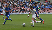 Leeds United's Jack Harrison crosses the ball despite the attentions of  Wigan Athletic's Sam Morsy (left)  and Lee Evans <br /> <br /> Photographer Stephen White/CameraSport<br /> <br /> The EFL Sky Bet Championship - Wigan Athletic v Leeds United - Saturday 17th August 2019 - DW Stadium - Wigan<br /> <br /> World Copyright © 2019 CameraSport. All rights reserved. 43 Linden Ave. Countesthorpe. Leicester. England. LE8 5PG - Tel: +44 (0) 116 277 4147 - admin@camerasport.com - www.camerasport.com