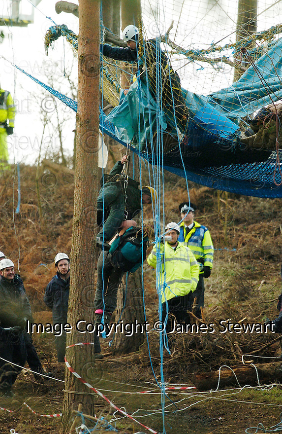 23/01/2006         Copyright Pic: James Stewart.File Name : sct_jspa16_dalkeith.MEMBERS OF THE NATIONAL EVICTION TEAM THROW A TOPLESS PROTESTER OVER THE EDGE OF HER TREE TOP CAMP AND LOWER HER TO THE GROUND AT DALKEITH PARK.......Payments to :.James Stewart Photo Agency 19 Carronlea Drive, Falkirk. FK2 8DN      Vat Reg No. 607 6932 25.Office     : +44 (0)1324 570906     .Mobile   : +44 (0)7721 416997.Fax         : +44 (0)1324 570906.E-mail  :  jim@jspa.co.uk.If you require further information then contact Jim Stewart on any of the numbers above.........