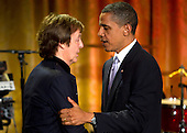United States President Barack Obama speaks to former Beatle Paul McCartney during a concert in the East Room of the White House in Washington, D.C., U.S., on Wednesday, June 2, 2010. Obama presented McCartney with the Gershwin Prize for Popular Song awarded by the Library of Congress. .Credit: Andrew Harrer / Pool via CNP