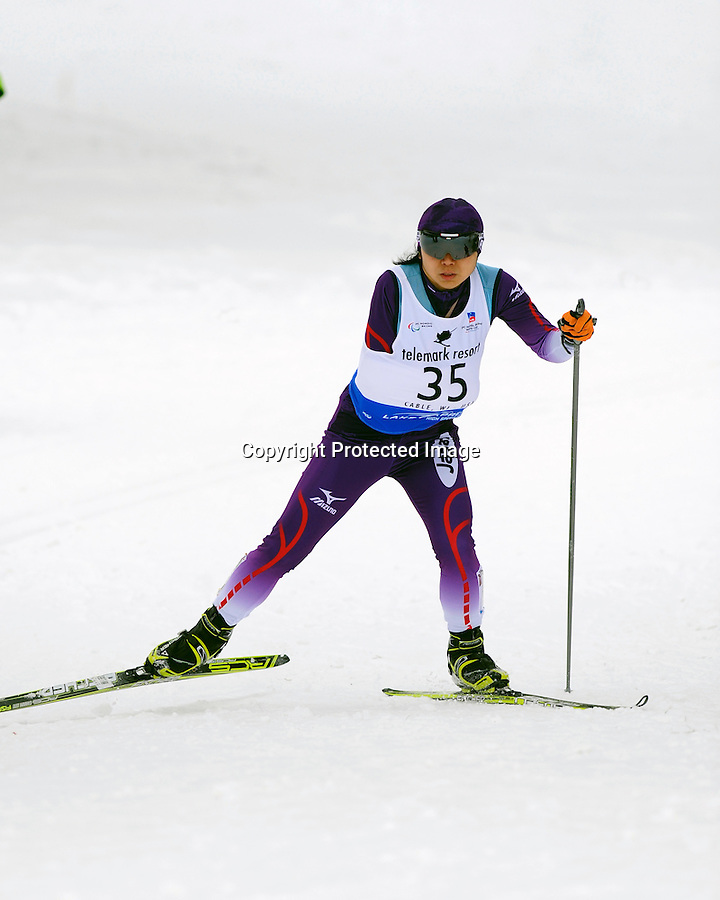 Momoko Dekijima of Team Japan competes in the BT Women Standing during the 2013 International Paralympics Nordic Skiing World Cup in Cable, WI.
