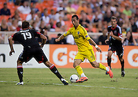 Emiliano Dudar (19) of D.C. United tries to stay in front of Justin Meram (9) of the Columbus Crew during the game at RFK Stadium in Washington, DC.  D.C. United defeated the Columbus Crew, 1-0.