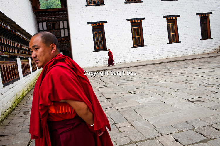 Buddhist monks seen at the Tashichhodzong (fortress of auspicious religion) in the capital city Thimphu, Bhutan. Photo: Sanjit Das/Panos