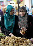 Women shopping in the market of the Nuseirat refugee camp in the middle of the Gaza strip.  While Gazans grow much of their own food, repressive restrictions on land use imposed by the Israeli military means some food has to be imported at great cost from Egypt and Israel....