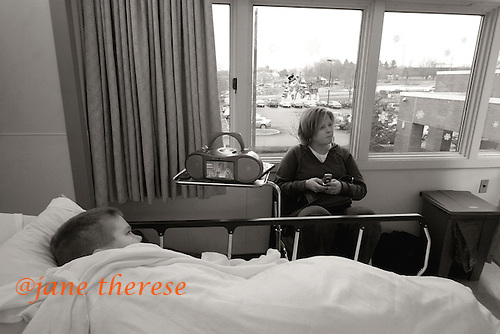 "Drew watches TV, as Jill phones her husband to brief him on the day. It's been a long and stressful day for both Jill and Drew, spending what has now been 5 hours at the hospital for what could have been a routine office visit. With an autistic child, there is no such thing as ""routine"". Braces would have been an option for Drew had he not been autistic. However, putting braces on Drew with his biting was not even a consideration. photo by jane therese"