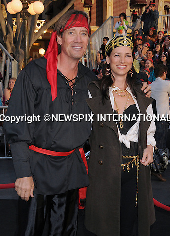 "KEVIN SORBO AND SAM JENKINS.attends World Premiere of ""Pirates of the Caribbean: On Stranger Tides"" held at Disneyland Anaheim, California_07/05/2011. .Mandatory Photo Credit: ©Crosby/Newspix International..**ALL FEES PAYABLE TO: ""NEWSPIX INTERNATIONAL""**..PHOTO CREDIT MANDATORY!!: NEWSPIX INTERNATIONAL(Failure to credit will incur a surcharge of 100% of reproduction fees)..IMMEDIATE CONFIRMATION OF USAGE REQUIRED:.Newspix International, 31 Chinnery Hill, Bishop's Stortford, ENGLAND CM23 3PS.Tel:+441279 324672  ; Fax: +441279656877.Mobile:  0777568 1153.e-mail: info@newspixinternational.co.uk"