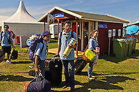 People arriving with thei Suitcase on World Scout Jamboree