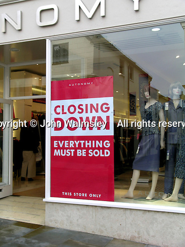 "Closing Down Sale sign in shop window, ""Everything must be sold""."