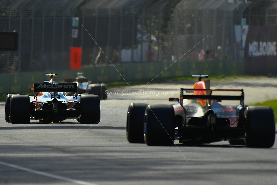 March 26, 2017: The McLaren Honda and Redbull Racing cars round turn two at the 2017 Australian Formula One Grand Prix at Albert Park, Melbourne, Australia. Photo Sydney Low
