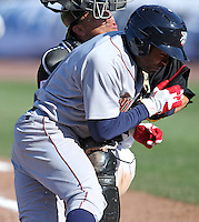 Lehigh Valley Ironpigs second baseman Josh Barfield #5 collides with catcher Rene Rivera #13 during the second game of a double header against the Rochester Red Wings at Frontier Field on April 14, 2011 in Rochester, New York.  Lehigh Valley defeated Rochester 5-3 in extra innings.  Photo By Mike Janes/Four Seam Images