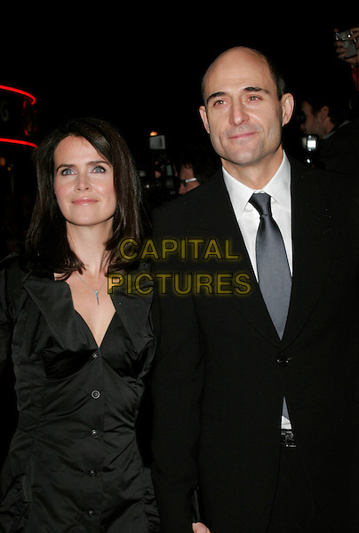 "MARK STRONG & GUEST .UK Premiere of ""Body of Lies"" at the Vue West End, Leicester Square, London, England, November 6th 2008..half length black tie suit grey gray .CAP/AH.©Adam Houghton/Capital Pictures"