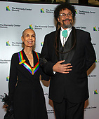 Past Kennedy Center honoree Carmen De Lavallade and her son, Leo Holder, arrive for the formal Artist's Dinner honoring the recipients of the 41st Annual Kennedy Center Honors hosted by United States Deputy Secretary of State John J. Sullivan at the US Department of State in Washington, D.C. on Saturday, December 1, 2018. The 2018 honorees are: singer and actress Cher; composer and pianist Philip Glass; Country music entertainer Reba McEntire; and jazz saxophonist and composer Wayne Shorter. This year, the co-creators of Hamilton, writer and actor Lin-Manuel Miranda, director Thomas Kail, choreographer Andy Blankenbuehler, and music director Alex Lacamoire will receive a unique Kennedy Center Honors as trailblazing creators of a transformative work that defies category.<br /> Credit: Ron Sachs / Pool via CNP