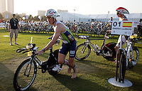 12 MAR 2011 - ABU DHABI, UAE - Frederik Van Lierde races out of transition to the bike ahead of Martin Jensen during the Abu Dhabi International Triathlon (PHOTO (C) NIGEL FARROW)