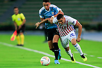ARMENIA, COLOMBIA - JANUARY 19: Paraguay's Hugo Fernandez fights for the ball against Uruguay's Jose Rodriguez during their CONMEBOL Pre-Olympic soccer game at Centenario Stadium on January 19, 2020 in Armenia, Colombia. (Photo by Daniel Munoz/VIEW press/Getty Images)