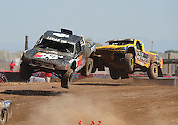 Apr 17, 2011; Surprise, AZ USA; LOORRS driver Kent Brascho leads Aaron Daugherty (24) during round 4 at Speedworld Off Road Park. Mandatory Credit: Mark J. Rebilas-