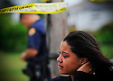 A young woman cries at the murder scene of Shadrach Angelain, a 22-year-old former prep football standout from New Orleans who was fatally shot early Tuesday in his Gentilly apartment, 2009.