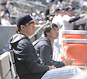 (L-R) Masahiro Tanaka (Yankees), Shingo Horie, APRIL 29, 2015 - MLB : Masahiro Tanaka of the New York Yankees watches from the dugout during the Major League Baseball game against the Tampa Bay Rays at Yankee Stadium in the Bronx, New York, United States. (Photo by AFLO)