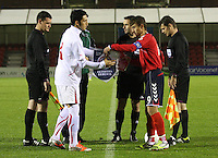 Team captains Levent Gulen (left) and Gor Malakyan exchange penants in the Armenia v Switzerland UEFA European Under-19 Championship Qualifying Round match at New Douglas Park, Hamilton on 11.10.12.