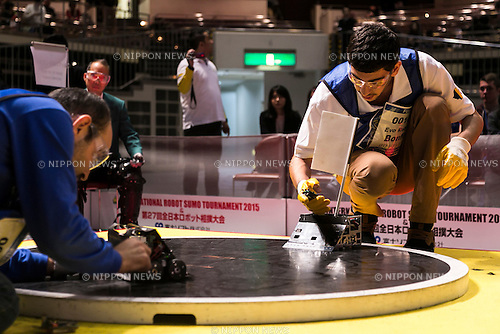 Robot operators compete at the International Robot Sumo Tournament 2015, in the Ryogoku Sumo Hall (Ryogoku Kokugikan) on December 13, 2015. The annual competition brings the winners from 14 robot sumo tournaments held globally, plus the Japanese winners of the All Japan Robot-Sumo National Tournament and All Japan Robot-Sumo Tournament (High-School class) to fight for the world's first place in two divisions: autonomous and radio controlled. The international tournament is part of the All Japan Robot-Sumo Tournament which has been held in various countries since 1989. According to the rules the robot wrestler loses when the robot is forced outside the sumo ring, simulating a traditional sumo fight. (Photo by Rodrigo Reyes Marin/AFLO)