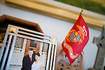 A photo of Rosaleen and her husband Rob, who has been handling much of the child care since her vigil began. A Marine flag sits behind it.. A day in the life of Rosaleen Tallon, sister of firefighter Sean Tallon killed in the 9/11 World Trade Center attacks. In response to the proposed WTC memorial being built underground at the site, Ms. Tallon has been sleeping for 16 days in front of the fire house across from the WTC site. She and several other WTC families are protesting the memorial design and asking for the victim's names to be placed above ground for the sake of honoring the lives lost and safety concerns with any possible future evacuation of the site.