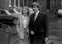 Willy O&rsquo;Dea, TD, Fianna Fail, Rep of Ireland, arriving at Leinster House for a new session of the Dail, Irish Parliament, December, 1982. He is accompanied by his wife, 198212000284WOD<br /><br />Copyright Image from Victor Patterson, 54 Dorchester Park, <br />Belfast, UK, BT9 6RJ<br /><br />t1: +44 28 9066 1296 (from Rep of Ireland 048 9066 1296)<br />t2: +44 28 9002 2446 (from Rep of Ireland 048 9002 2446)<br />m: +44 7802 353836<br /><br />victorpatterson@me.com<br />www.victorpatterson.com<br /><br />Please see my Terms and Conditions of Use at VICTORPATTERSON.COM. It is IMPORTANT that you familiarise yourself with them.<br /><br />Images used on the Internet must be visibly watermarked i.e. &copy;VICTORPATTERSON.COM within the body of the image and copyright metadata must not be deleted. Images used on the Internet have a size restriction of 4kbs and are chargeable at the then current NUJ rates.<br /><br />This image is only available for the use of the download recipient i.e. television station, newspaper, magazine, book publisher, etc, and must not be passed on to any third party. It is also downloaded on condition that each and every usage is notified within 7 days to victorpatterson@me.com<br /><br />The right of Victor Patterson to be identified as the author is asserted in accordance with The Copyright Designs And Patents Act (1988).