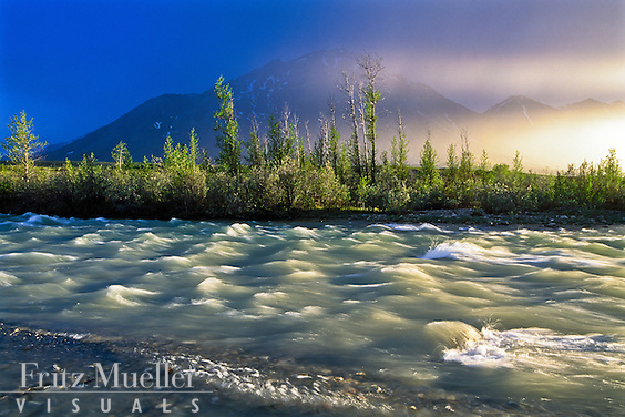 Midnight sun aureoles over the Snake River, Yukon