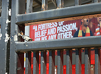 Anfield stadium during the suspension of the Premier League  Anfield, Liverpool, Merseyside, England;  Anfield, Liverpool, Merseyside, England; padlocked gates outside the entrance to the Kop
