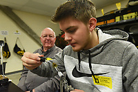 FROM FEATHERS TO FLY<br />Trevor Wolfe, a student at Bentonville High School, puts the final touches on a fishing fly Wednesday March 11 2020 with guidance from Steve Curtis, a member of the Bella Vista Fly Tyers. Students in the high school's outdoor education class tied flies that they'll use on a trout-fishing field trip to Roaring River State Park in April. Students tied woolly bugger flies in a variety of colors with help from club members. Go to nwaonline.com/200312Daily/ to see more photos.<br />(NWA Democrat-Gazette/Flip Putthoff)