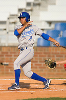 Yeldrys Molina #9 of the Burlington Royals follows through on his swing versus the Johnson City Cardinals at Howard Johnson Stadium June 27, 2009 in Johnson City, Tennessee. (Photo by Brian Westerholt / Four Seam Images)