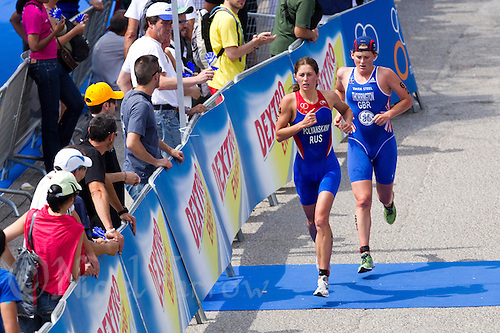 05 JUN 2011 - MADRID, ESP - Anastasiya Polyanskaya leads Abbie Thorrington on the run during the Madrid round of the women's ITU World Championship series (PHOTO (C) NIGEL FARROW)
