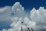 ST. PETERSBURG, FL - JUNE 18:  A general view of Capogrosso/Mehamed of Argentina vs. Kapa/McHugh of Australia at the net with clouds during the FIVB Beach Volleyball World Tour St. Petersburg Grand Slam presented by the AVP on June 18, 2015 at Spa Beach in St. Petersburg, Florida. (Photo by Donald Miralle for the AVP)