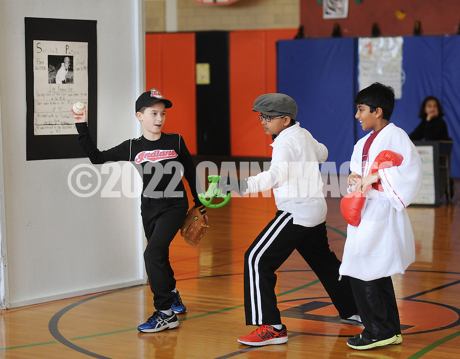 "From left, Chase Watson, 11, as Satchel Paige, Nmay Mahajan, 10 as Rojo Jack and Shreyas Swaroop, 10 as Muhammad Ali test out their poses as the 5th grade creates a ""wax museum"" of historic black figures to celebrate Black History Month at Fallsington Elementary School Monday February 23, 2015 in Fallsington, Pennsylvania. (Photo by William Thomas Cain/Cain Images)"
