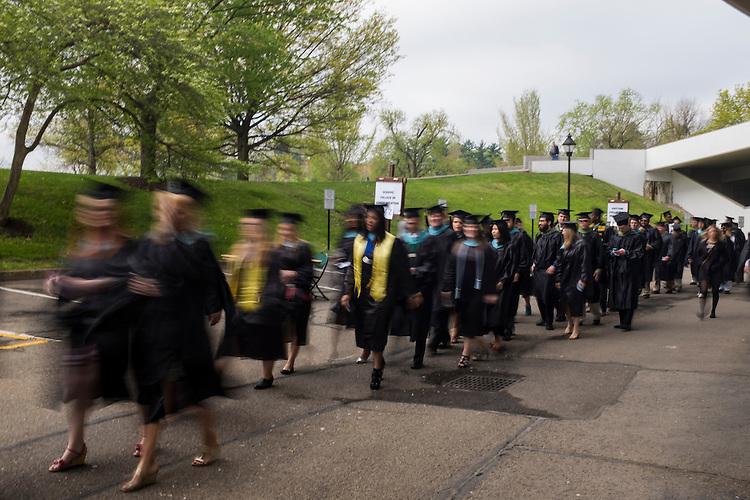 Students stream toward the Convocation Center before the start of Ohio University's Graduate Commencement ceremony on Friday, May 1, 2015.  Photo by Ohio University  /  Rob Hardin