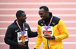 Usain Bolt (JAM, bronze, right) and Justin Gatlin (USA, gold) share a joke on the podium. Medal ceremony podium. IAAF world athletics championships. London Olympic stadium. Queen Elizabeth Olympic park. Stratford. London. UK. 06/08/2017. ~ MANDATORY CREDIT Garry Bowden/SIPPA - NO UNAUTHORISED USE - +44 7837 394578