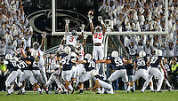 Ohio State Buckeyes wide receiver Jeff Greene (89) almost gets his fingers on the kick by Penn State Nittany Lions place kicker Sam Ficken (97) to send the game into overtime at Beaver Stadium on October 25, 2014.  (Chris Russell/Dispatch Photo)