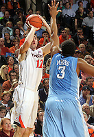 Virginia guard Joe Harris (12) shoots over North Carolina forward Kennedy Meeks (3) during the second half of an NCAA basketball game Monday Jan. 20, 2014 in Charlottesville, VA. Virginia defeated North Carolina 76-61. (Photo/Andrew Shurtleff)