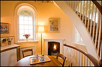 BNPS.co.uk (01202 558833)<br /> Pic: LandmarkTrust/BNPS<br /> <br /> Each of the four levels has a room on it connected by a spiral staircase.<br /> <br /> Revealed - Britain's most booked up room...and it's on a windswept clifftop on the Dorset coast.<br /> <br /> You might think the most popular getaway in Britain would be being pampered in a top London hotel or a swanky spa resort - but the Landmark Trust's Clavell Tower in Dorset is fully booked for the next two years - and hundreds of people are eagally awaiting the next release of dates to become avaiable.<br /> <br /> Holidaymakers who want to stay in a stunning clifftop tower that inspired literary greats Thomas Hardy and PD James will have a long wait - as it is fully booked until July 2019.<br /> <br /> The striking Clavell Tower overlooking Kimmeridge Bay in Dorset, is so popular the Landmark Trust, which runs the property, says as soon as six months of new dates are made available in the spring those will be booked up too.<br /> <br /> The Grade II listed 40ft tower, which was built in 1830, was saved from a watery grave by the Landmark Trust, a building conservation charity, more than a decade ago and opened to the public as a quirky holiday let in August 2008.<br /> <br /> Ever since then it has proved incredibly popular and currently has an 18-month waiting list - because that's as far ahead as the trust's booking calendar goes.
