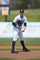 Kannapolis Intimidators starting pitcher John Parke (27) looks to his catcher for the sign against the Lakewood BlueClaws at Kannapolis Intimidators Stadium on April 8, 2018 in Kannapolis, North Carolina.  The Intimidators defeated the BlueClaws 5-1 in game one of a double-header.  (Brian Westerholt/Four Seam Images)