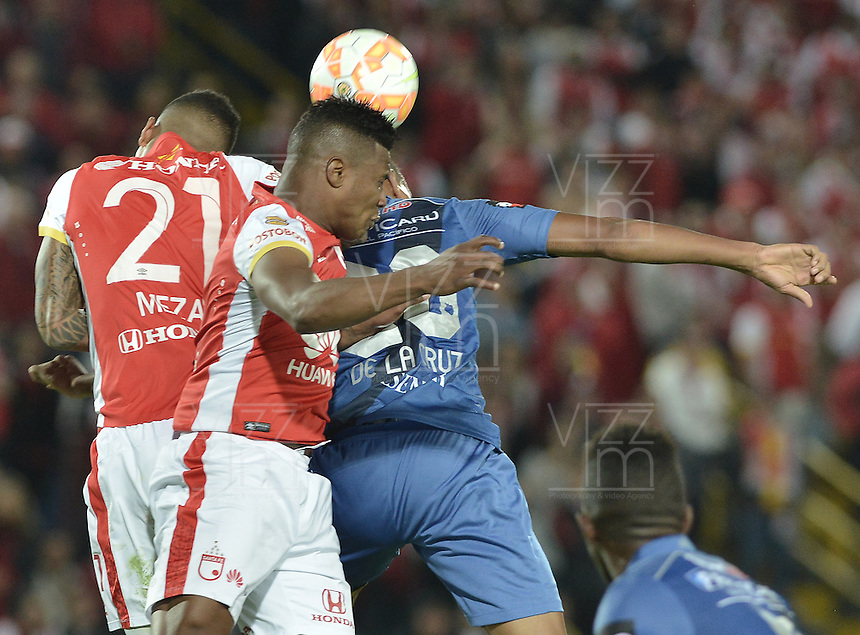 BOGOTÁ - COLOMBIA -29-09-2015: Francisco Meza (Izq) y Wilson Morelo (C) jugadores de Independiente Santa Fe (COL) saltan por el balón con Robert Burbano (Der) jugador de Emelec (ECU) durante partido de vuelta por octavos de final, llave C, de la Copa Sudamericana 2015 jugado en el estadio Nemesio Camacho El Campín de la ciudad de Bogota./ Francisco Meza (L) and Wilson Morelo (C) players of Independiente Santa Fe (COL) jumps for the ball with xxx (R) player of Emelec (ECU) during the second leg match for the knockout stages, key C, of the Copa Sudamericana 2015 played at Nemesio Camacho El Campin stadium in Bogota city.  Photo: VizzorImage/ Gabriel Aponte /Staff