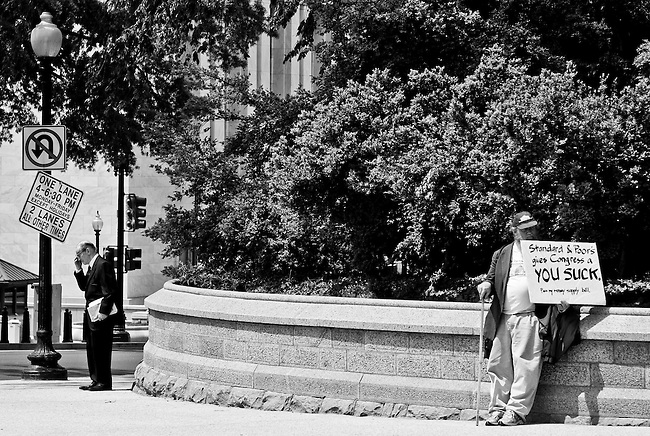 Former Federal Reserve chairman Alan Greenspan, left, stands outside of the U.S. Capitol on Independence Avenue waiting for his ride on May 3, 2011. (Photo By Bill Clark/Roll Call)