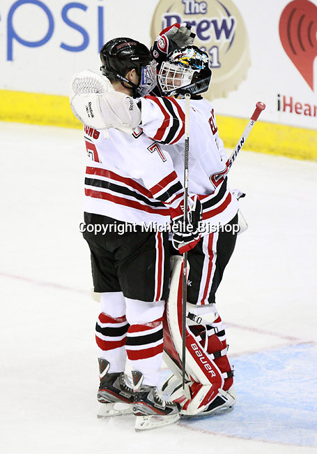 Nebraska Omaha's Michael Young and goalie Dayn Belfour celebrate UNO's 4-1 exhibition win over the University of British Columbia. (Photo by Michelle Bishop) ..