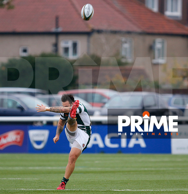 Ealing's Aaron Penberthy with a big kick during the Greene King IPA Championship match between Ealing Trailfinders and Bedford Blues at Castle Bar , West Ealing , England  on 29 October 2016. Photo by Carlton Myrie / PRiME Media