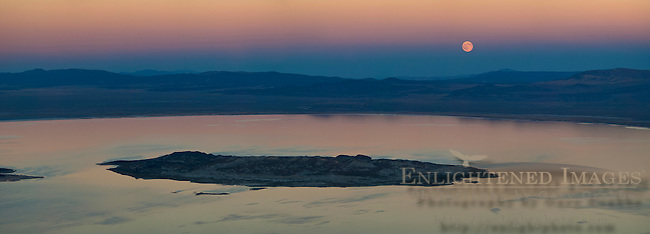 Panorama of full moon rising over Mono Lake at sunset; Mono County; Eastern Sierra; California