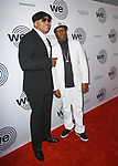 LL Cool J (left) and Grandmaster Flash arrive at the We Are Family Foundation 2018 celebration gala at the Hammerstein Ballroom in New York City, on April 27 2018.