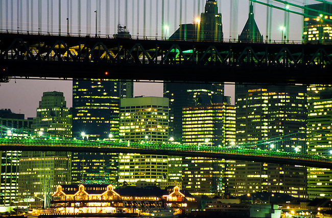 Close up telephoto shot of skyscrapers and bridges at twilight in New York City, USA