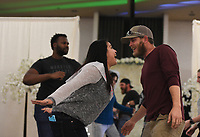 """Melie Rodriguez (left) dances with Dane Ketzler of Prairie Grove during a dancing competition, Sunday, January 26, 2020 during the Kiss the Brides Expo at the Northwest Arkansas Convention Center in Springdale. Check out nwaonline.com/200127Daily/ for today's photo gallery.<br /> (NWA Democrat-Gazette/Charlie Kaijo)<br /> <br /> The annual Kiss the Brides Expo entered its tenth year in Northwest Arkansas with 100 exhibitors, runway shows and games and contests for engaged couples. Over 1,200 people and 400 brides attended the one day event. <br /> <br /> """"The pages of a wedding magazine comes to life,"""" said Ralph Desuse, executive producer of Kiss the Brides Expo."""