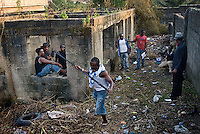 Actors and crew on the set of a Nollywood movie production. Outside locations are not artificially lit, and at dusk the filming has to be done quickly..
