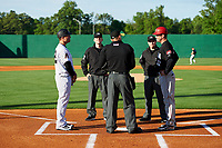 Jackson Generals manager J.R. House (22) meets with Chattanooga Lookouts manager Jake Mauer (12) and umpires Brock Ballou, Lewis Williams and Matt Winter before a game against the Jackson Generals on April 27, 2017 at The Ballpark at Jackson in Jackson, Tennessee.  Chattanooga defeated Jackson 5-4.  (Mike Janes/Four Seam Images)