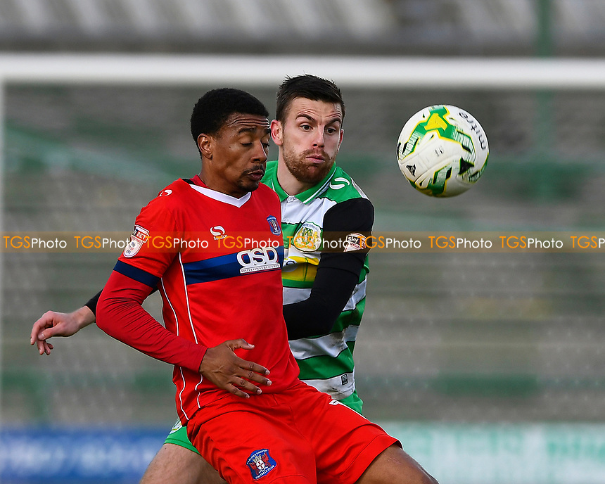 Kevin Dawson of Yeovil Town challenges Reggie Lambe of Carlisle United during Yeovil Town vs Carlisle United, Sky Bet EFL League 2 Football at Huish Park on 1st April 2017